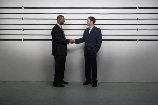 Stock Photo: 1589R-37968 Multi-ethnic businessmen shaking hands in police line up