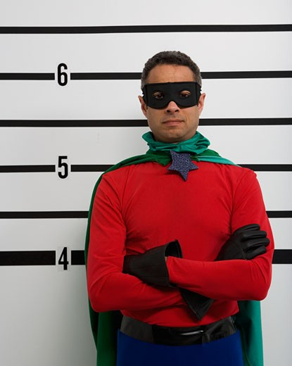 Male superhero standing in police line up : Stock Photo