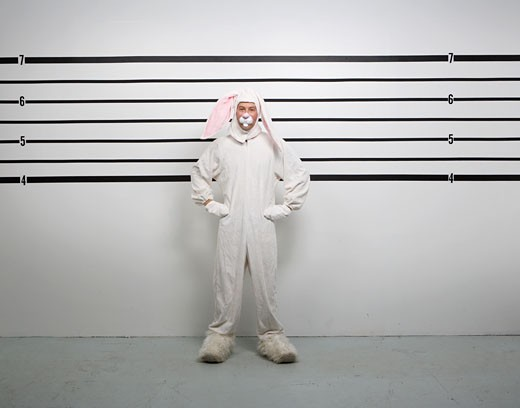 Person in rabbit suit in police line up : Stock Photo