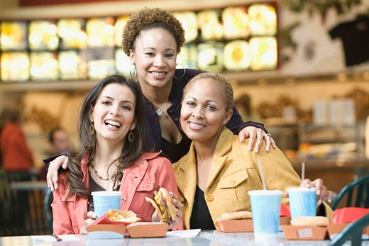 Stock Photo: 1589R-38079 Multi-ethnic women eating in mall