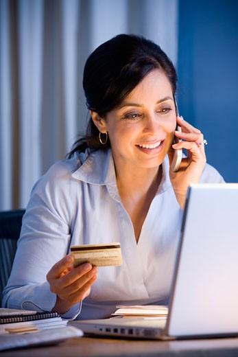 Stock Photo: 1589R-38443 Hispanic businesswoman shopping online