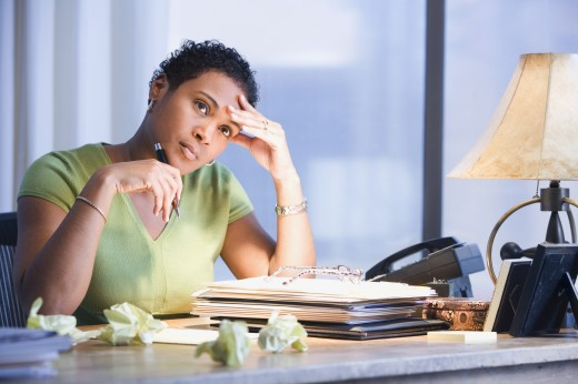 Stock Photo: 1589R-38467 African businesswoman thinking
