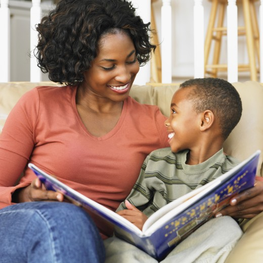Stock Photo: 1589R-38547 African American mother and son reading