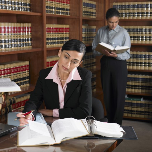 Stock Photo: 1589R-38579 Hispanic female lawyers working in office