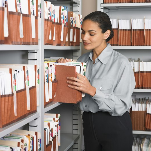 Stock Photo: 1589R-38584 Hispanic businesswoman in file room