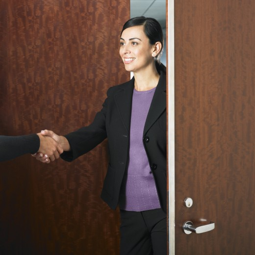 Stock Photo: 1589R-38589 Hispanic businesswoman shaking hands