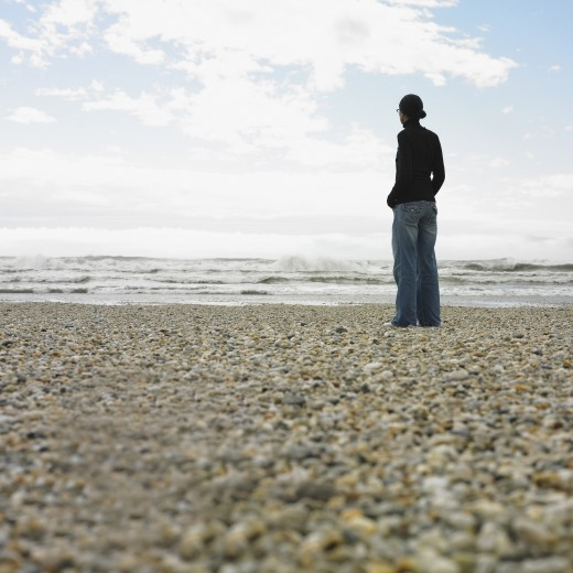 Stock Photo: 1589R-38597 Hispanic woman standing on rocky beach