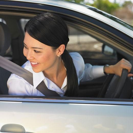 Eurasian woman driving car : Stock Photo