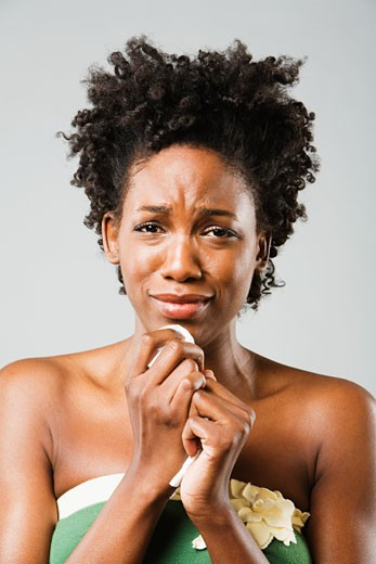 Stock Photo: 1589R-38817 African American woman crying