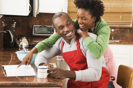 Stock Photo: 1589R-38841 African American couple reading cookbook