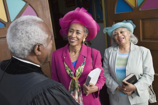 Stock Photo: 1589R-38874 Senior African American women talking to Reverend