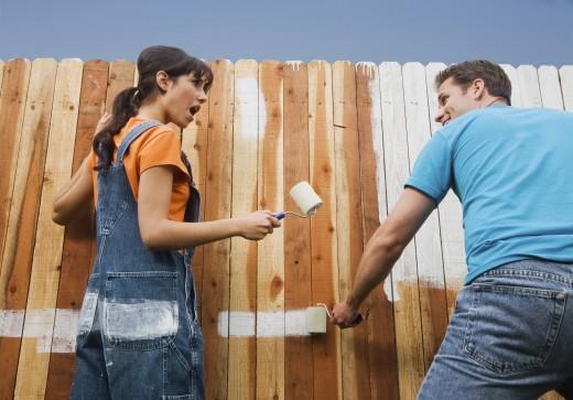 Stock Photo: 1589R-38914 Multi-ethnic couple painting fence
