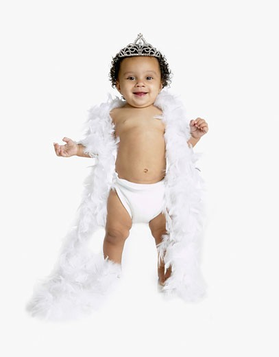 Stock Photo: 1589R-39184 African baby wearing feather boa and tiara