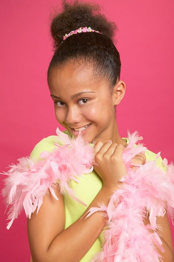 Stock Photo: 1589R-39231 African girl wearing feather boa