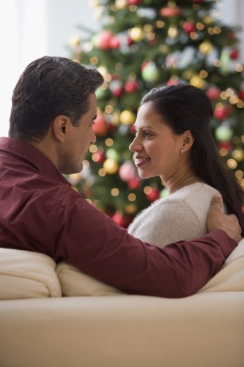 Stock Photo: 1589R-39403 Hispanic couple smiling at each other