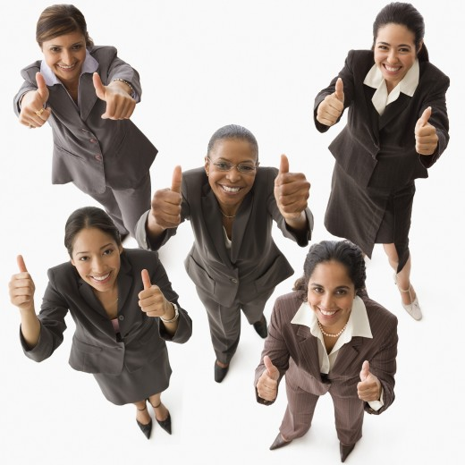Multi-ethnic businesswoman giving thumbs up : Stock Photo