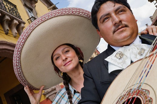 Stock Photo: 1589R-39535 Hispanic woman with Mariachi player