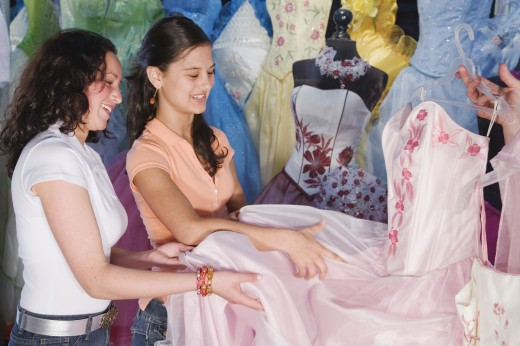 Stock Photo: 1589R-39589 Hispanic girls looking at Quinceanera dress