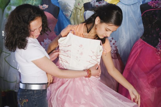 Stock Photo: 1589R-39590 Hispanic girl trying on Quinceanera dress