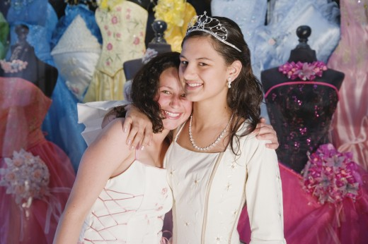 Two Hispanic girls in Quinceanera dresses : Stock Photo