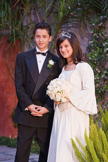 Stock Photo: 1589R-39613 Hispanic girl in Quinceanera dress with chamberlain