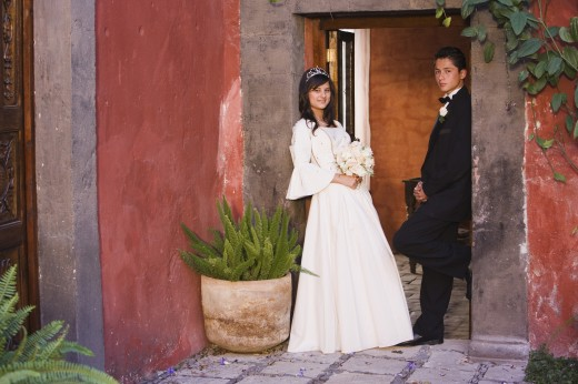 Stock Photo: 1589R-39616 Hispanic girl in Quinceanera dress with chamberlain