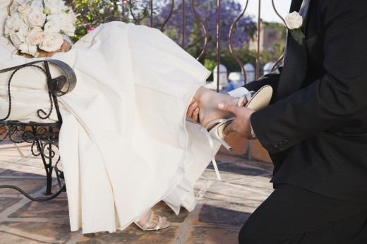 Stock Photo: 1589R-39620 Hispanic father putting shoe on daughter at Quinceanera