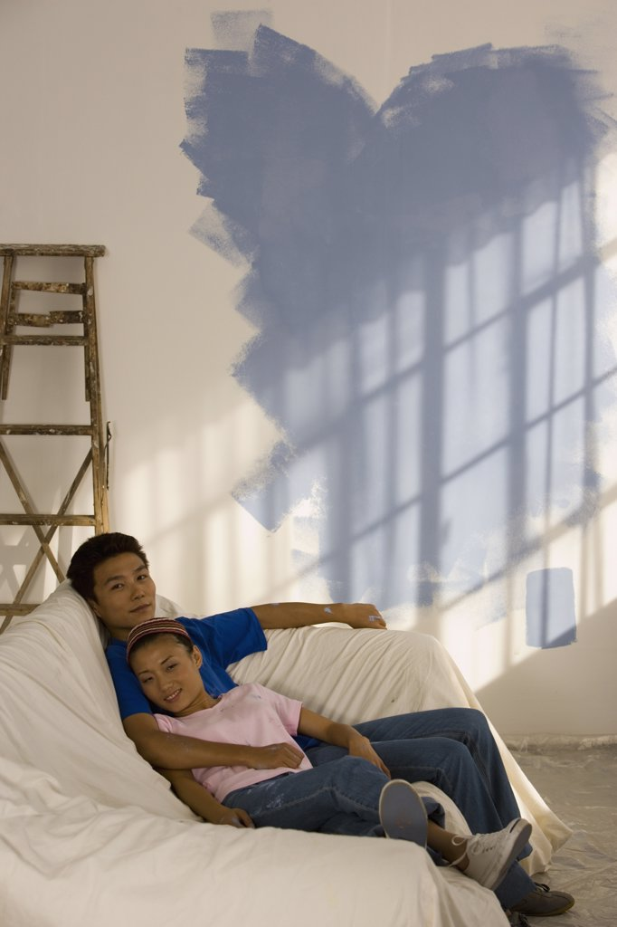 Stock Photo: 1589R-39867 Asian couple in partially painted room