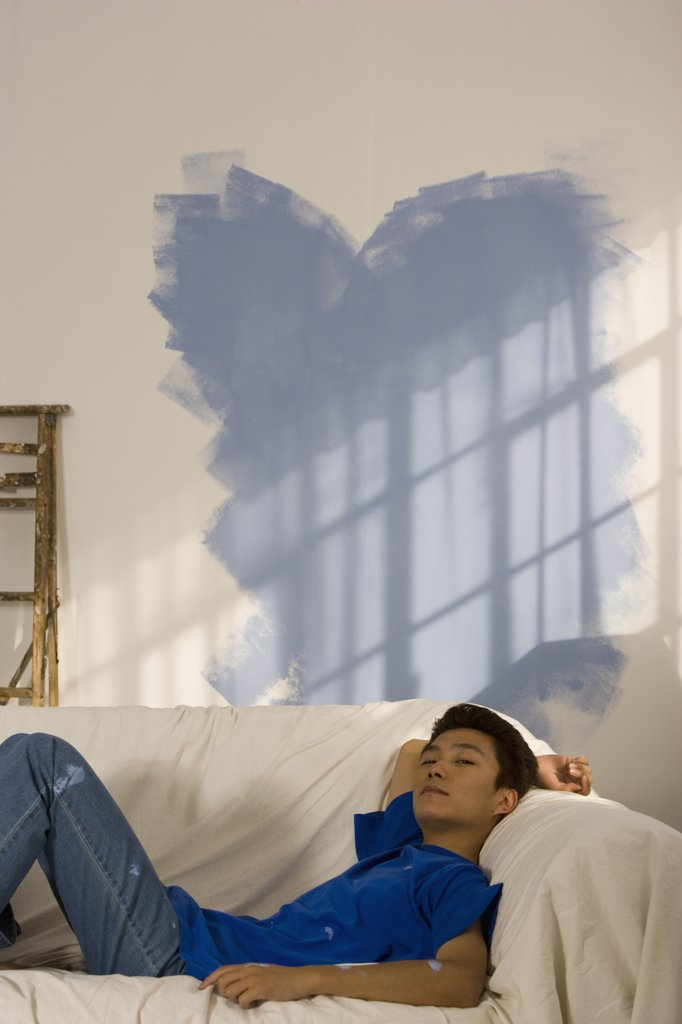 Stock Photo: 1589R-39872 Asian man in partially painted room