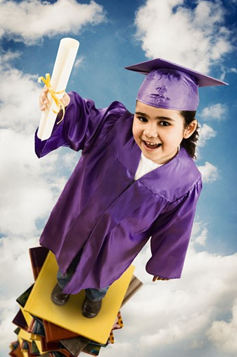 Stock Photo: 1589R-39941 African girl wearing graduation cap and gown