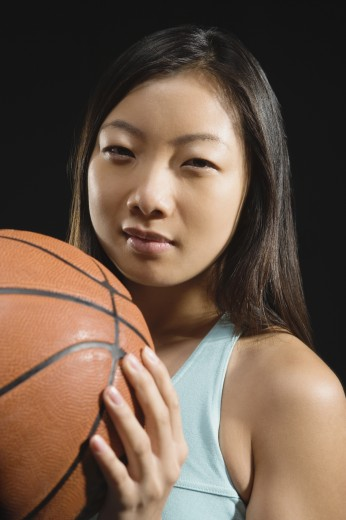 Asian woman holding basketball : Stock Photo