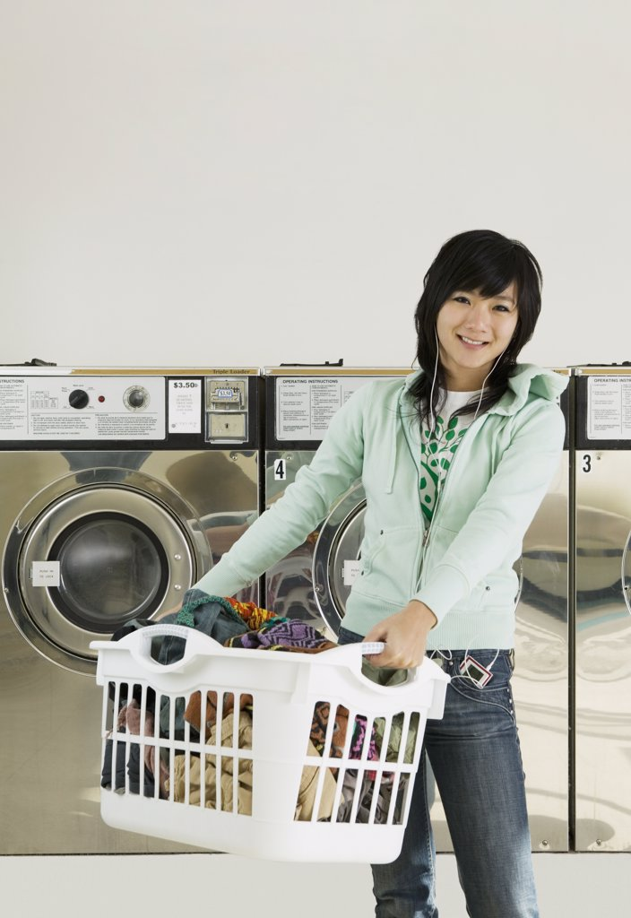 Stock Photo: 1589R-40216 Asian woman in laundromat
