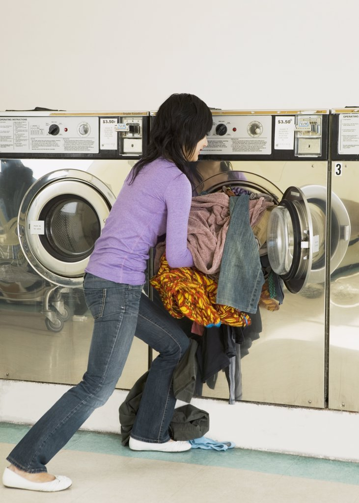 Asian woman in laundromat : Stock Photo