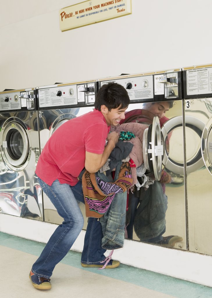 Stock Photo: 1589R-40228 Asian man in laundromat