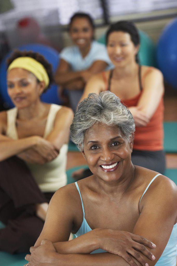 Multi-ethnic women in exercise class : Stock Photo