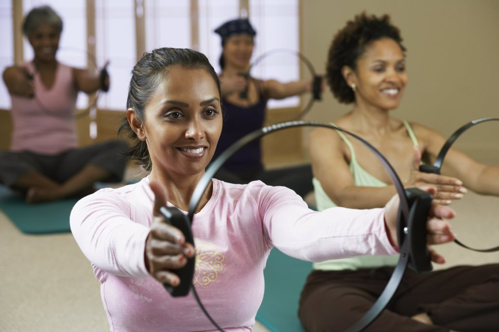 Stock Photo: 1589R-40423 Multi-ethnic women in exercise class