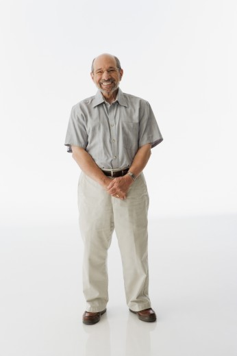 Stock Photo: 1589R-40448 Senior man standing with hands clasped