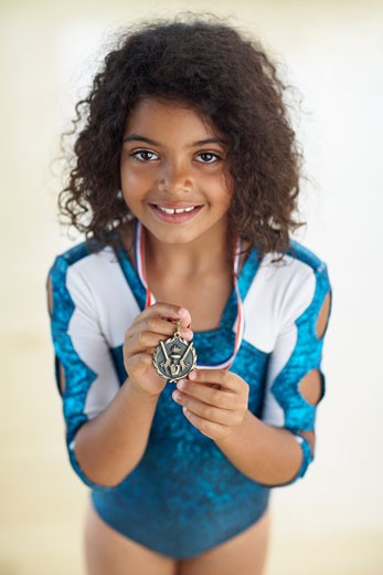 Stock Photo: 1589R-40766 Young female gymnast wearing medal