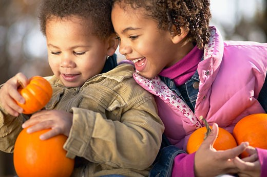 Stock Photo: 1589R-40810 African sister and brother holding pumpkins