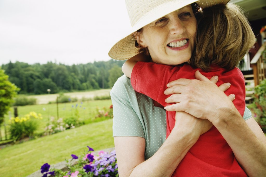 Stock Photo: 1589R-40836 Mother hugging child outdoors