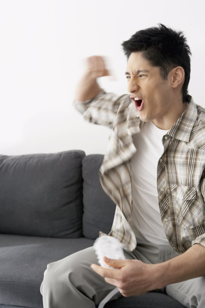 Asian man playing video games : Stock Photo