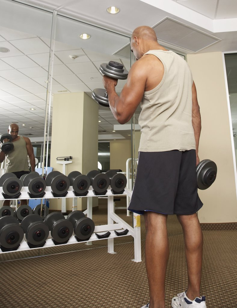 Stock Photo: 1589R-41058 Mixed Race man lifting weights