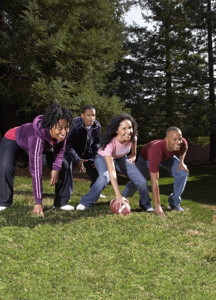 Stock Photo: 1589R-41116 Multi-ethnic friends playing football