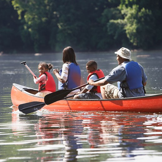 Stock Photo: 1589R-41264 African American family in canoe
