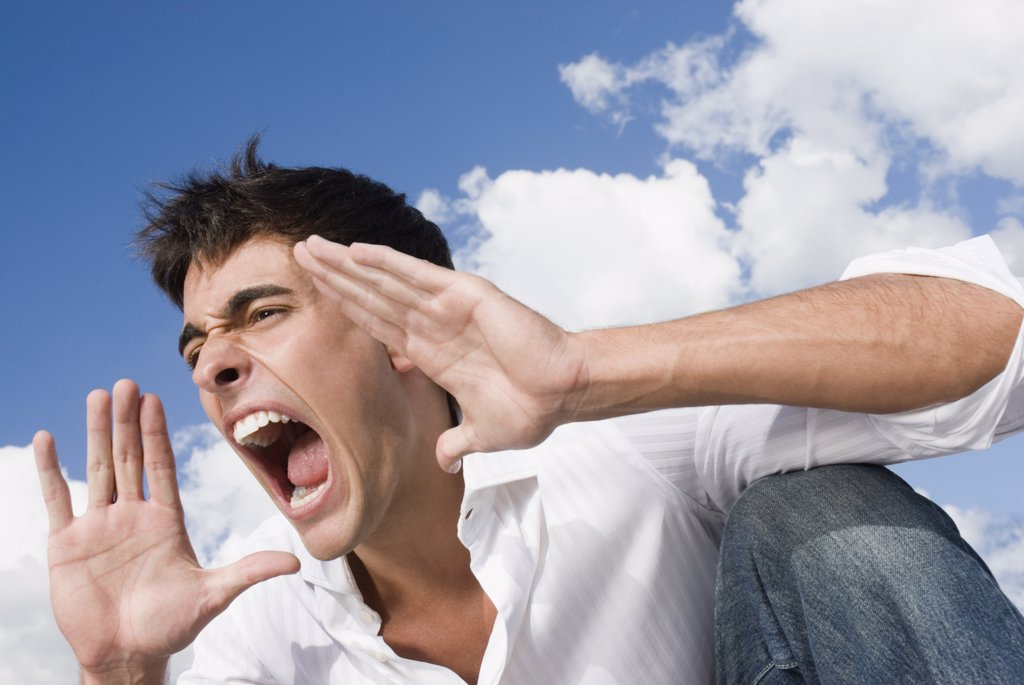 Man yelling with hands up : Stock Photo