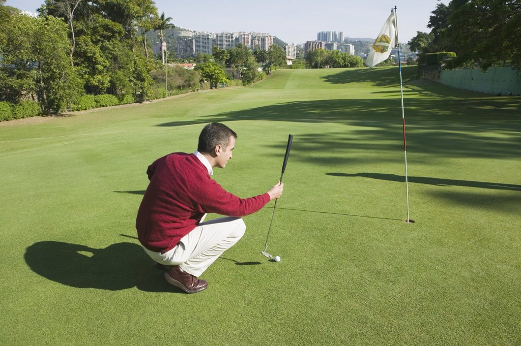 Stock Photo: 1589R-41524 Hispanic man playing golf
