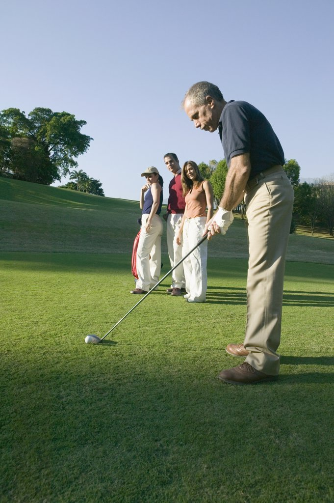 Stock Photo: 1589R-41529 Hispanic man playing golf