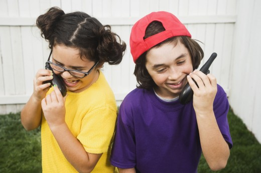 Stock Photo: 1589R-41629 Mixed Race children talking on walkie talkies