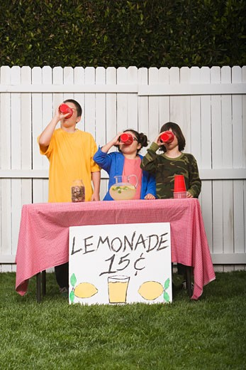 Stock Photo: 1589R-41645 Mixed Race children selling lemonade