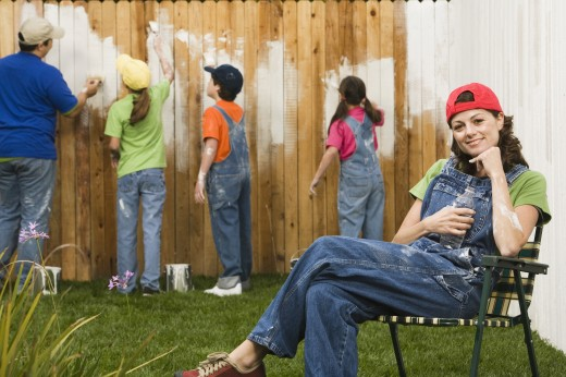 Stock Photo: 1589R-41671 Mixed Race family painting fence